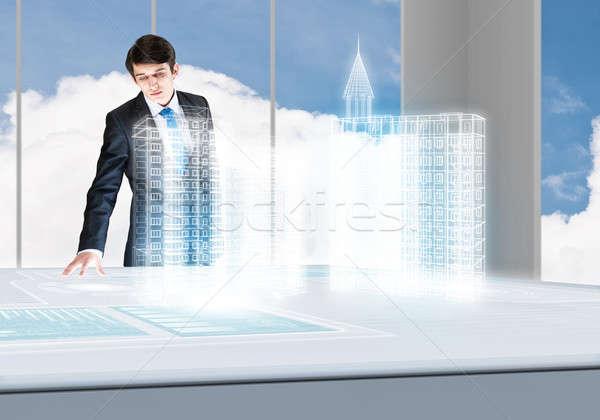 Innovativo giovani imprenditore guardando ologramma Foto d'archivio © adam121