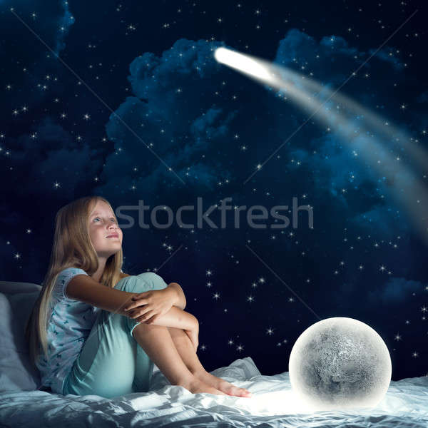 Girl in her bed and moon planet Stock photo © adam121