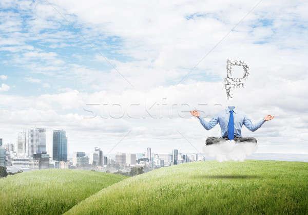 Headless meditating businessman Stock photo © adam121