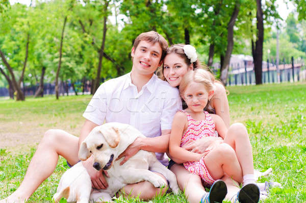 Happy young family with Labrador Stock photo © adam121