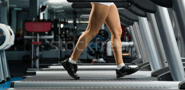 woman running on a treadmill Stock photo © adam121
