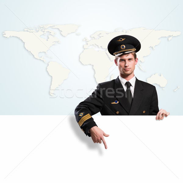 pilot in the form of holding an empty billboard Stock photo © adam121