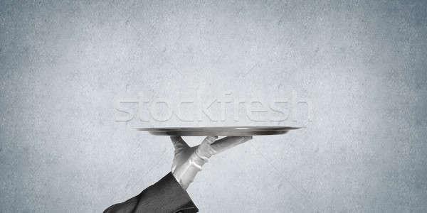 Main butler vide métal plateau Photo stock © adam121