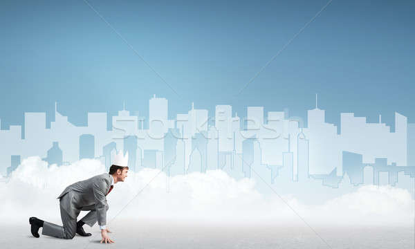 King businessman in elegant suit running and blue cityscape silhouette at background Stock photo © adam121