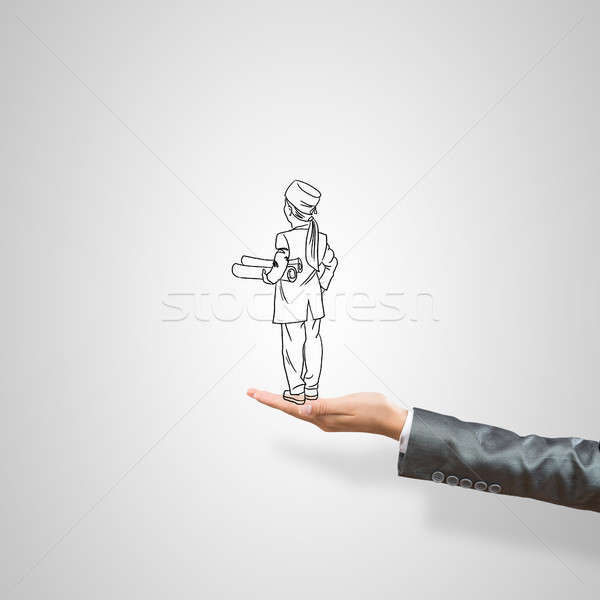Caricatures of businesswoman in palm Stock photo © adam121