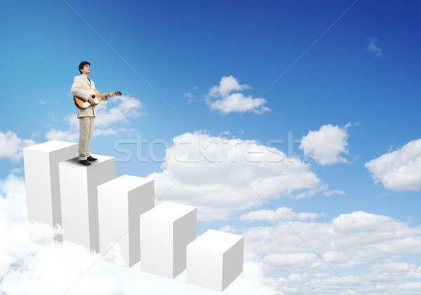 üzletember játszik gitár teljes alakos fiatal öltöny Stock fotó © adam121