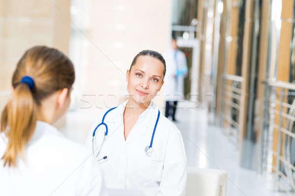 Dwa lekarzy mówić lobby szpitala uśmiech Zdjęcia stock © adam121