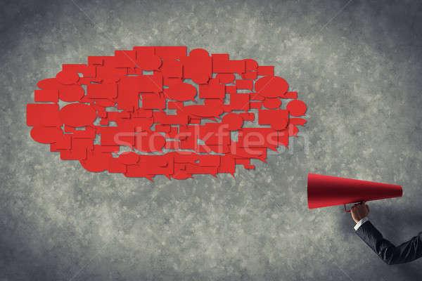 Kéz üzletasszony tart piros papír trombita Stock fotó © adam121