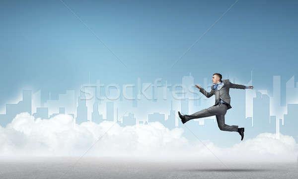 Empresário saltando alto jovem cidade corrida Foto stock © adam121