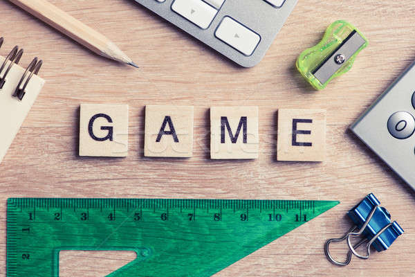 Elements of education game spelling words on wooden office table Stock photo © adam121