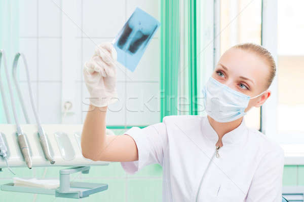 woman doctor in protective mask looking at x-ray Stock photo © adam121