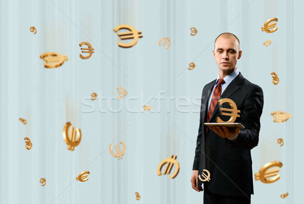 man holding tablet with euro symbol Stock photo © adam121