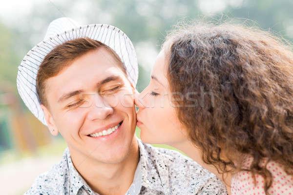 Menina beijando homem bochecha tempo mulher Foto stock © adam121