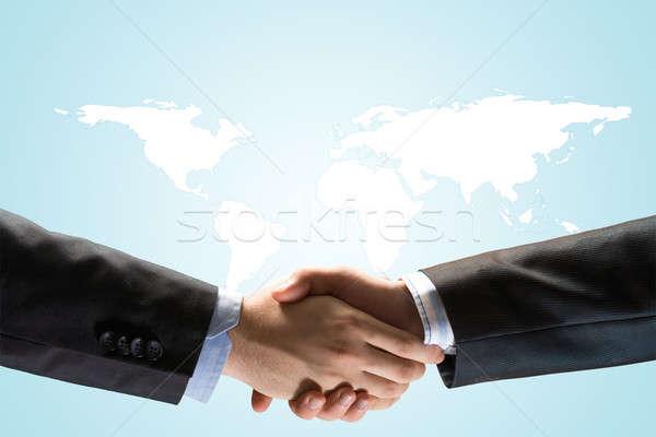 Two businessmen shaking hands Stock photo © adam121