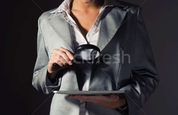 business woman holding a magnifying glass Stock photo © adam121