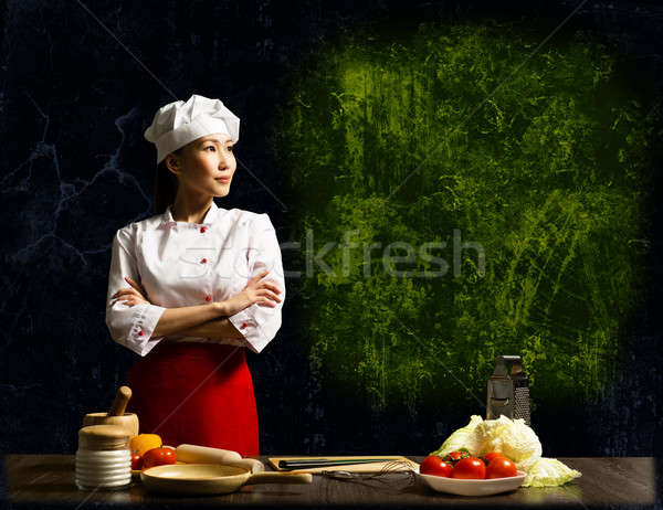Asian female chef looking at the empty space Stock photo © adam121