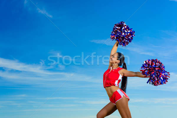 Young cheerleader in red costume with pampon Stock photo © adam121
