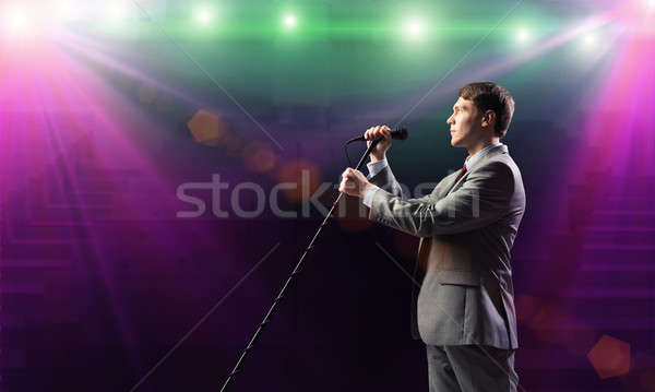 Businessman with microphone Stock photo © adam121