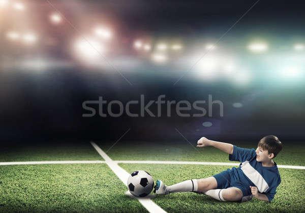 Jogo de futebol criança menino estádio Foto stock © adam121