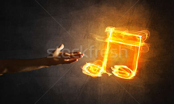 Music concept presented by fire burning icon and creation gesture Stock photo © adam121