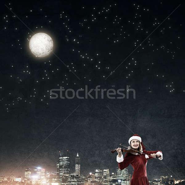 Melodia christmas atrakcyjny młoda kobieta Święty mikołaj garnitur Zdjęcia stock © adam121