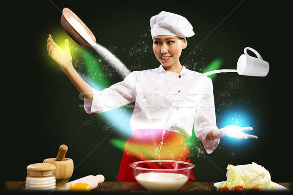 Asian female chef in the kitchen conjures Stock photo © adam121