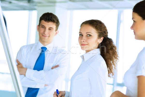 Empresarios reunión rotafolio negocios especialista Foto stock © adam121