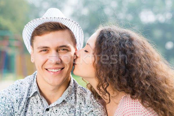 Meisje zoenen man wang tijd vrouw Stockfoto © adam121