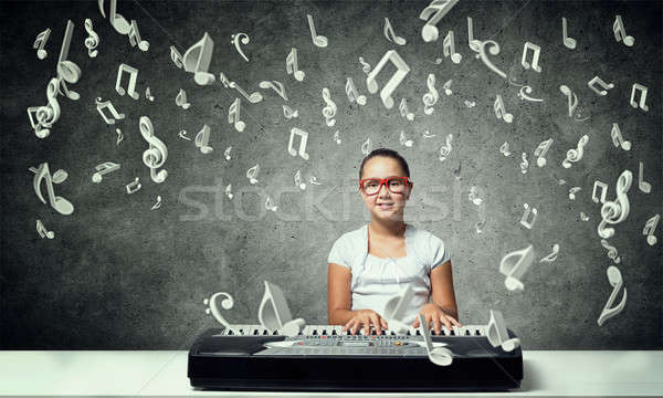 Kid girl play synthesizer Stock photo © adam121