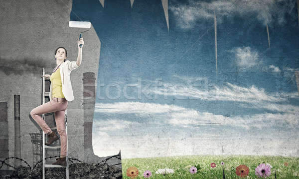 Girl paint wall in colors Stock photo © adam121