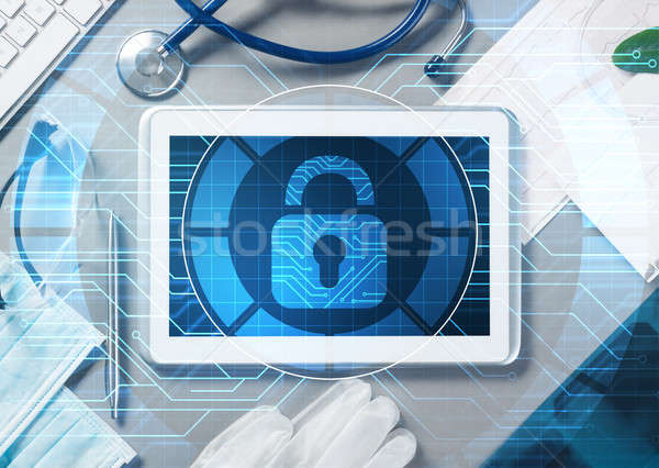 Top view of doctor workplace with tablet pc and medicine tools on wooden table Stock photo © adam121