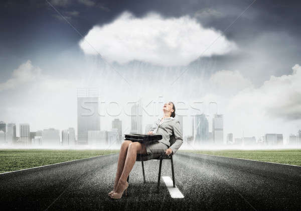 Businesswoman overcoming challenges Stock photo © adam121