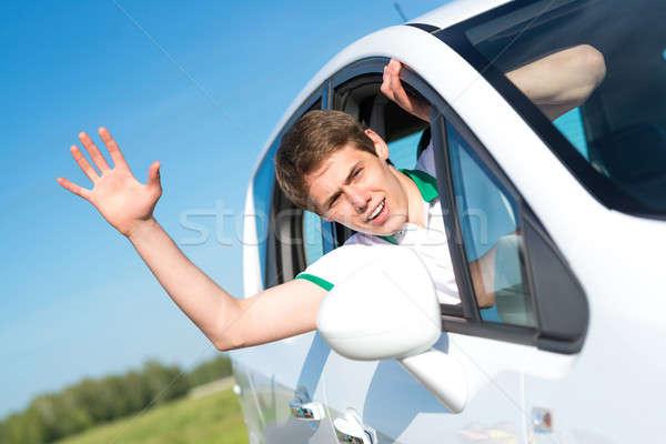 Férfi leragasztott kéz ki ablak fiatalember Stock fotó © adam121