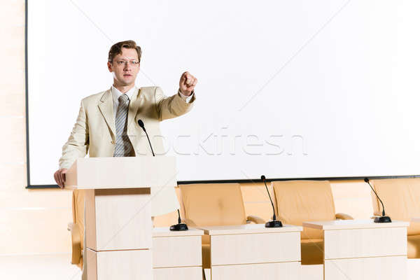 Stock fotó: Férfi · hangszóró · mögött · pódium · színpad · néz