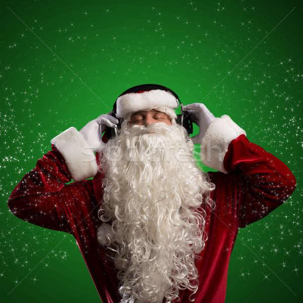 Papá noel escuchar música auriculares detrás resumen fiesta Foto stock © adam121