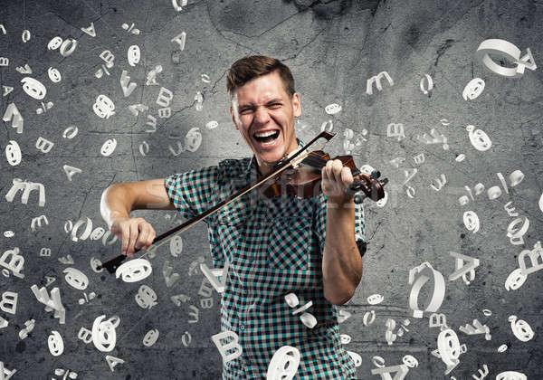 Zenész játszik hegedű fiatal jóképű fickó Stock fotó © adam121