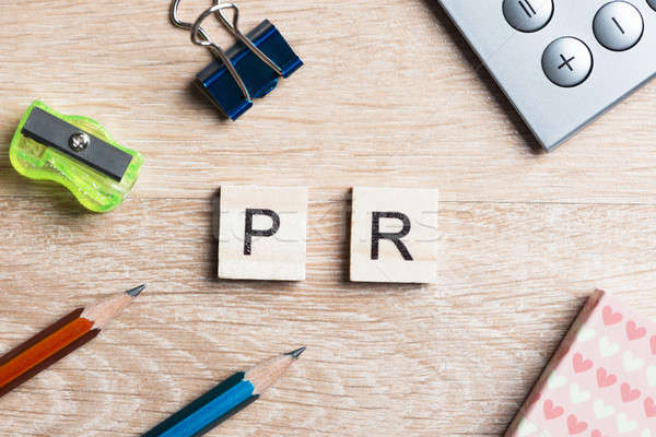 PR abbreviation on table spelled with education game elements Stock photo © adam121