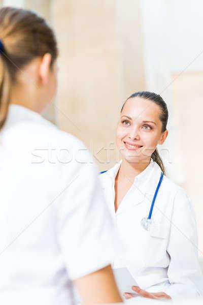 Dwa lekarzy mówić lobby szpitala posiedzenia Zdjęcia stock © adam121