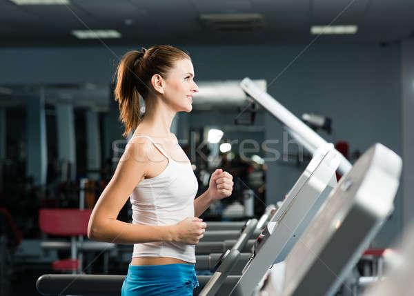 Vonzó fiatal nő futópad eljegyezve fitnessz sport Stock fotó © adam121