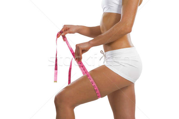 athletic woman measuring thigh Stock photo © adam121