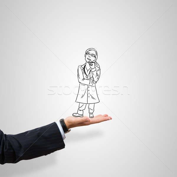 Kobieta lekarza mężczyzna dłoni szary Zdjęcia stock © adam121