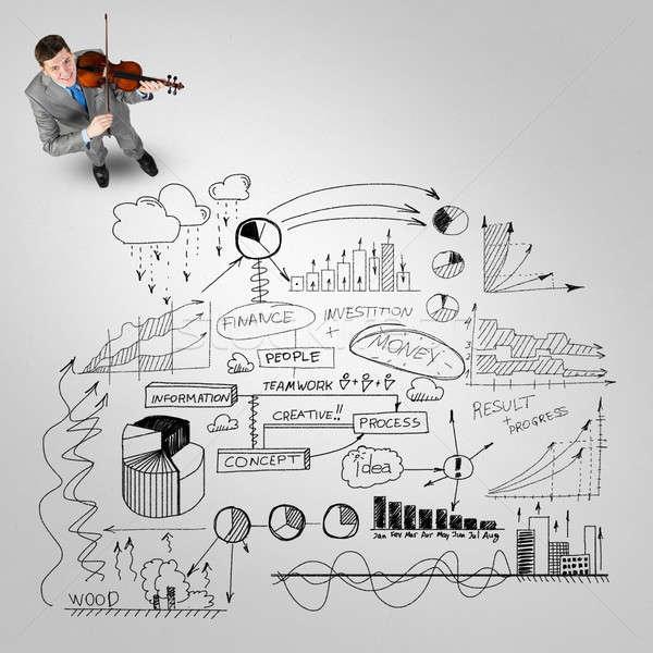 Empresario jugar éxito melodía superior vista Foto stock © adam121