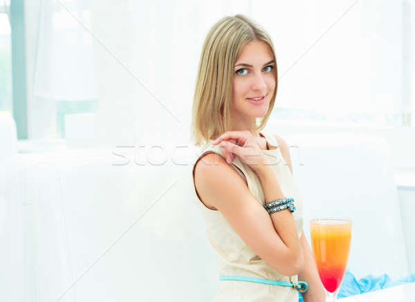 Portrait of a cute woman in a city cafe Stock photo © adam121