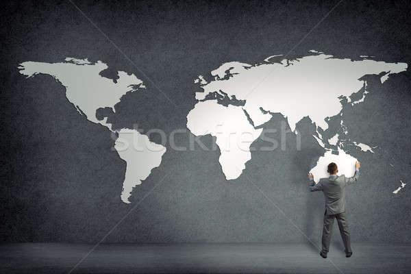 üzletember fal kontinensek földrész Ausztrália kéz Stock fotó © adam121