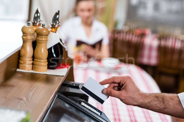 waiter inserts the card into a computer terminal Stock photo © adam121