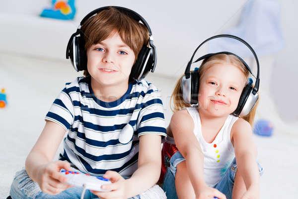 Aranyos fiú lány játszik számítógépes játékok konzol Stock fotó © adam121
