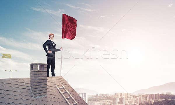 Fiatal üzletember zászló bemutat irányítás áll Stock fotó © adam121