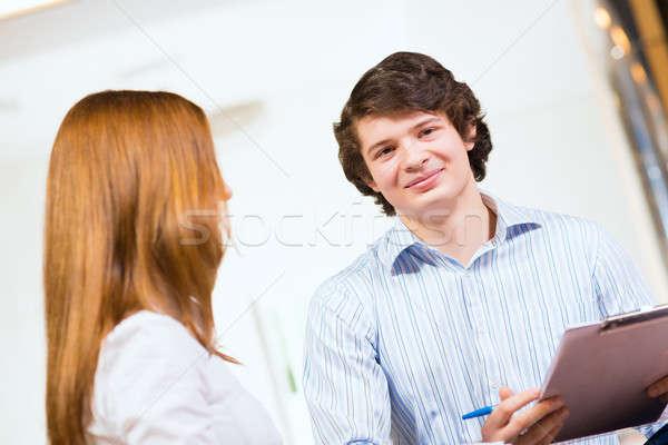 Retrato pessoas de negócios atraente moço mulher sessão Foto stock © adam121