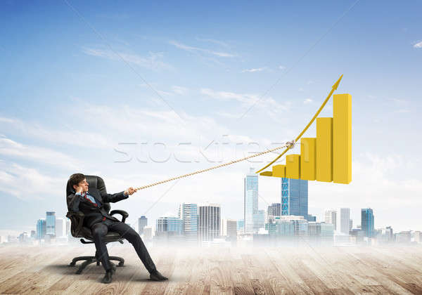 Man pulling with effort big pulling rope graph, as a symbol of financial growth Stock photo © adam121