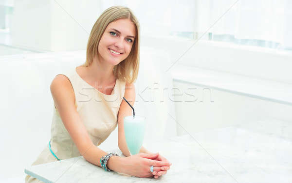 Stock photo: portrait of a beautiful woman in the cafe